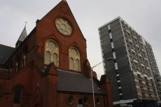 "Old and new: St Chad's Church, built 1868, next to a housing estate. The church was described as ""part of the massive Victorian effort to bring the workers of East London into the Anglican Church."""