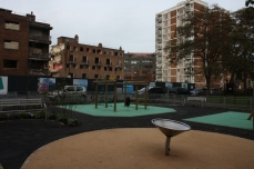 Playground with demolishing buildings behind.