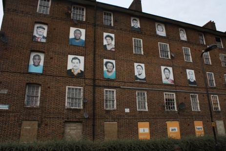 The Haggerston Estate, which has been due for redevelopment for a few years. An artists' collective has put up photos of former residents over the boarded windows.